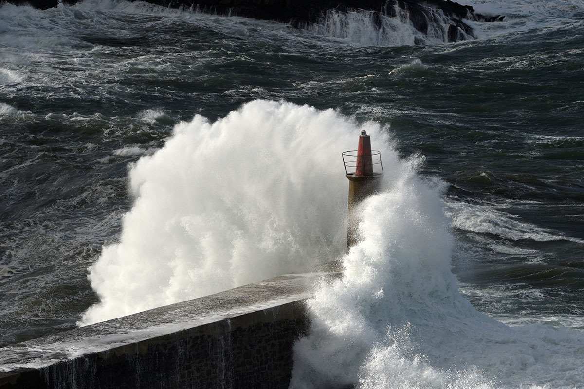 The strong winds hit northern Spain first, churning up an angry sea. [Eloy Alonso/Reuters]