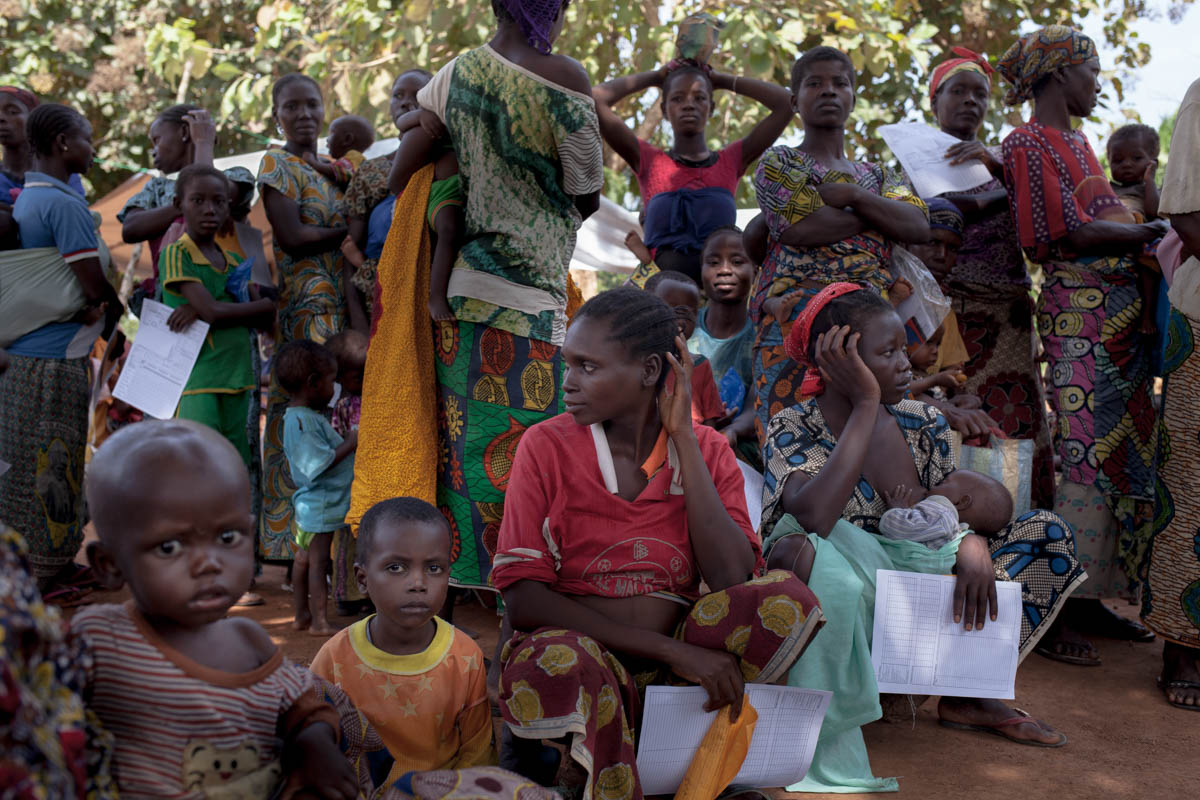 Women and children wait to be examined at a health centre near the Catholic mission. [Adrienne Surprenant/Al Jazeera]