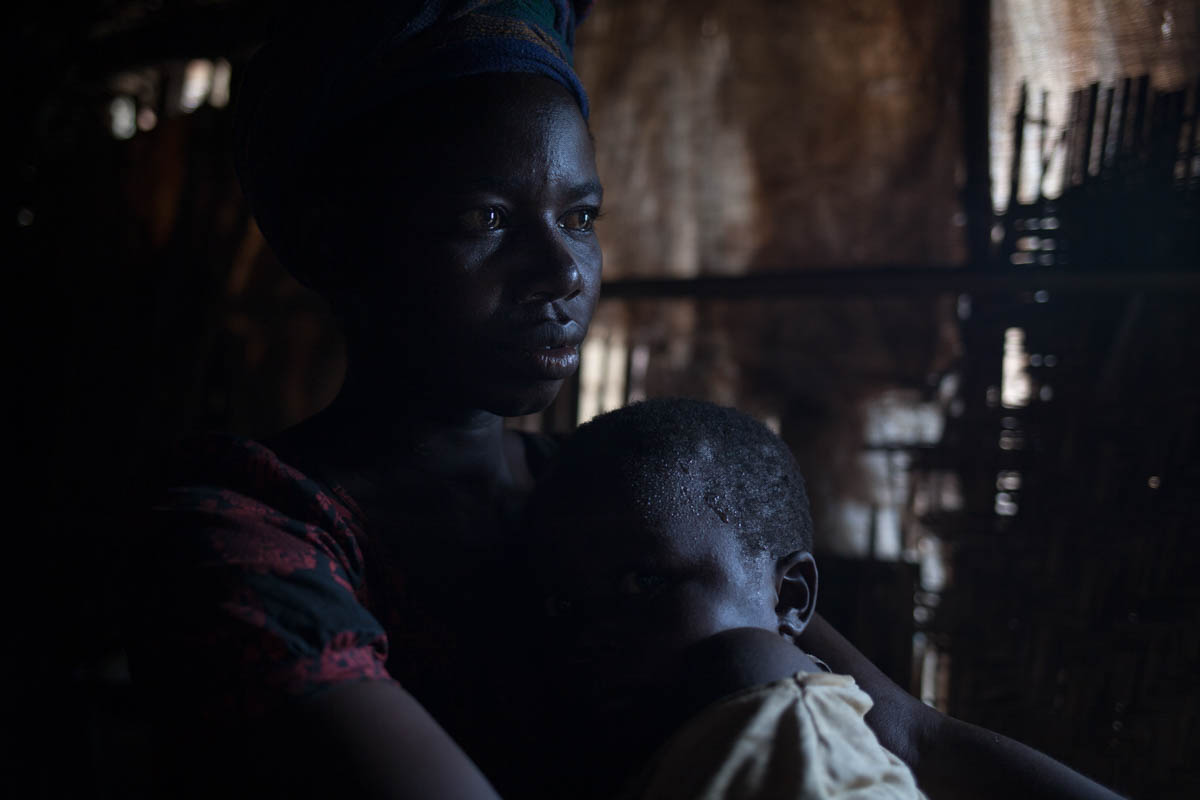The husband of Solange Yanga-Kotto, a 35-year-old mother of seven, was killed in front of her in May. She now lives at the Catholic church IDP site, struggling to care for her family alone. [Adrienne Surprenant/Al Jazeera]