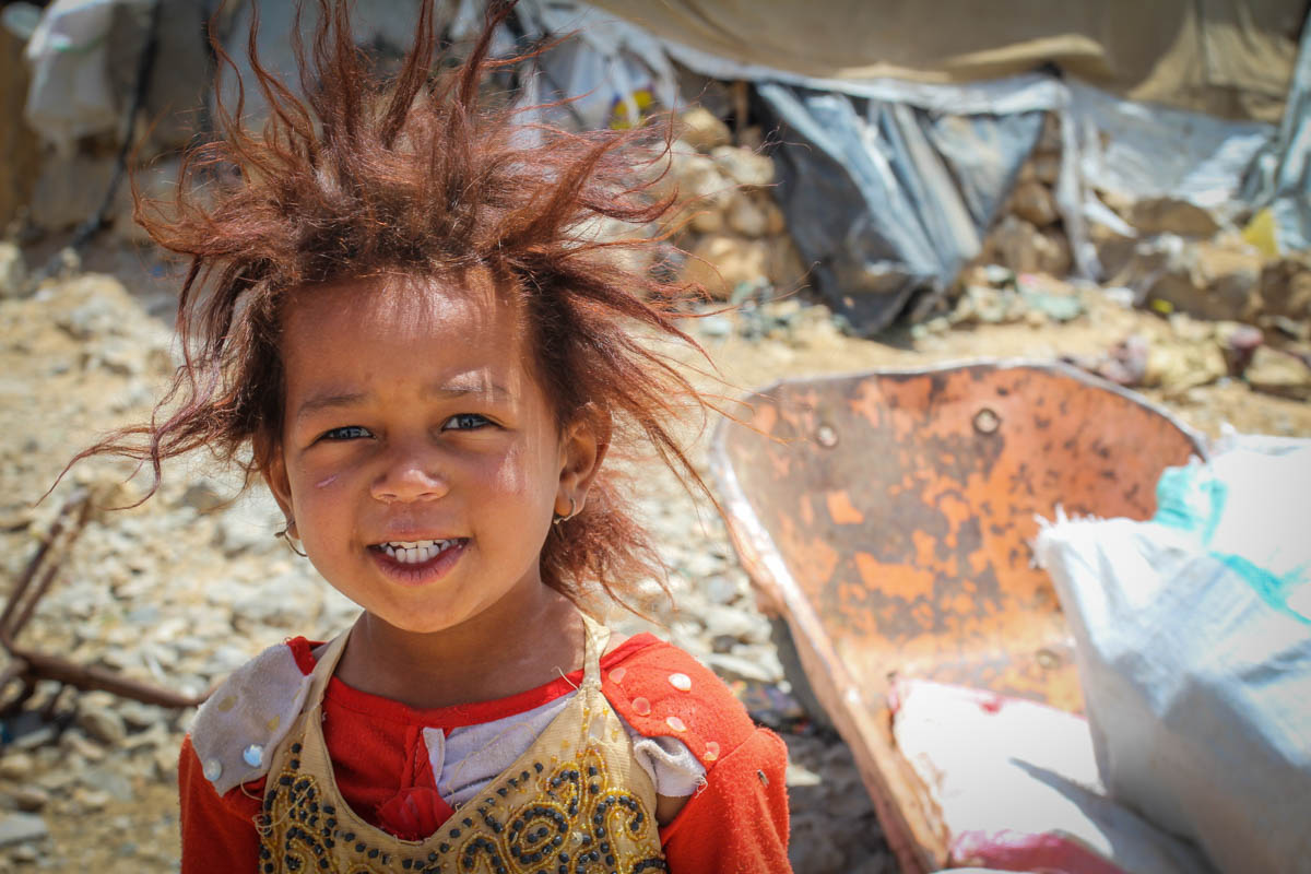 Ahlam, 4, has spent two years in an informal settlement outside Houth in northern Yemen, living in extremely dire conditions. Her family fled from Saada in 2015 after their neighbourhood came under attack. [Alvhild Stromme/NRC/Al Jazeera]