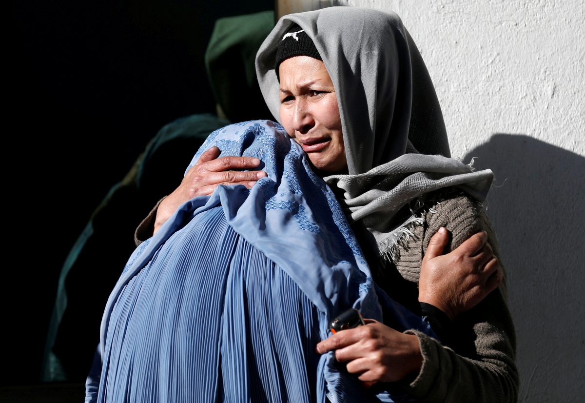 Afghan women mourn inside a hospital compound after a suicide attack in Kabul, Afghanistan. At least 40 people were killed and dozens wounded in a blast at a compound comprising a news agency, Shia cultural centre and religious school. [Mohammad Ismail/Reuters]