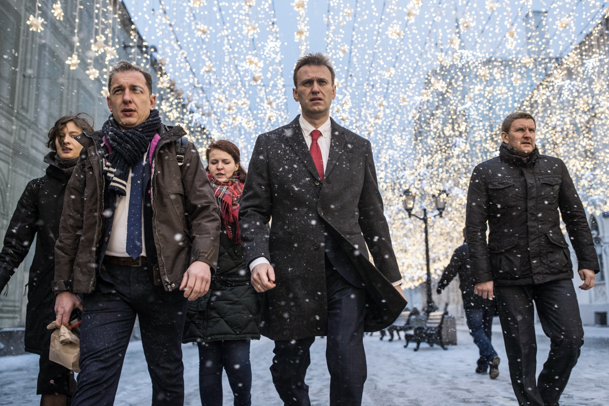 Russian opposition leader Alexei Navalny, who submitted the endorsement papers necessary for his registration as a presidential candidate, heads to a meeting at Russia's Central Election commission in Moscow. Russian election officials have formally barred Navalny from running for president. [Evgeny Feldman/Navalny Campaign/AP Photo]