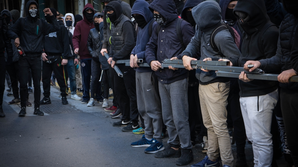 Greek police arrest 12 amid raids on anarchist squats