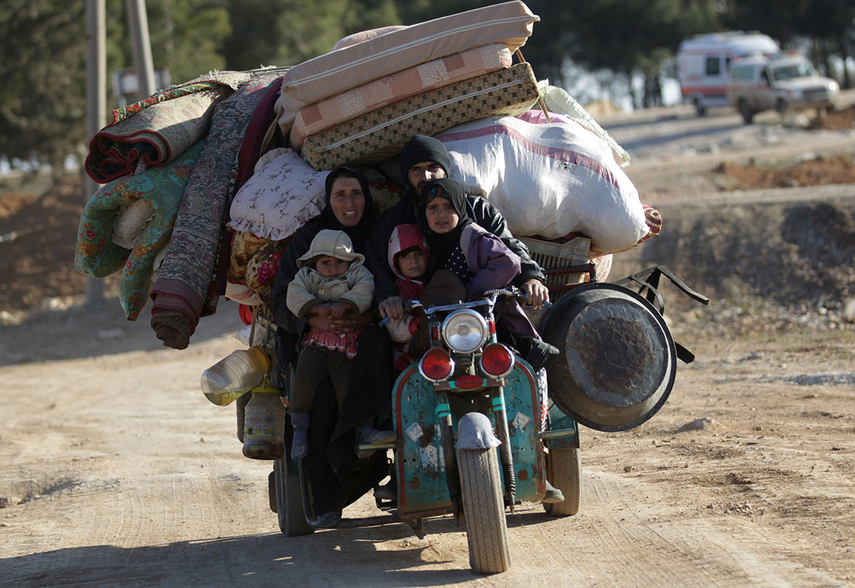 People who fled the violence from the ISIL-controlled northern Syrian town of al-Bab arrive in the rebel-held outskirts of the town, Syria. [Khalil Ashawi/Reuters]