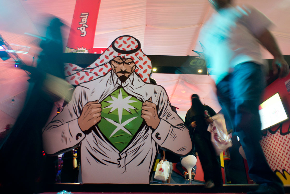 Visitors enter Saudi Comic Con (SCC) which is the first event of its kind to be held in Jeddah, Saudi Arabia. [AP]