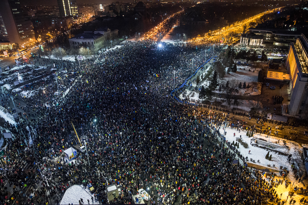 Around 150,000 people protested on Wednesday, February 1 in front of government headquarters n Bucharest after the Romanian government passed an emergency decree to decriminalise official misconduct the day before. [Ioana Moldovan/Al Jazeera]