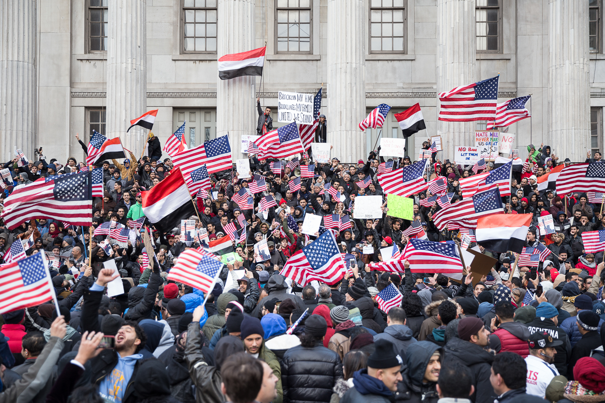 Hundreds gather at Brooklyn Borough Hall in the Brooklyn Heights neighbourhood in the early afternoon. Organisers set the eight-hour strike from 12pm and planned a rally for nightfall, but participants began to arrive immediately after closing their stores. [Kelly Lynn Lunde/Al Jazeera]