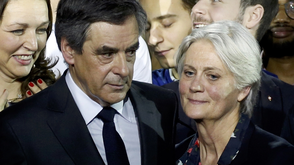 FILE PHOTO - Francois Fillon, former French prime minister, member of The Republicans political party and 2017 presidential candidate of the French centre-right, and his wife Penelope Fillon stand clo