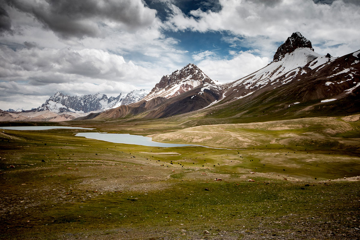 Underneath 6,000 metre-high mountains sits the Pamir plateau. Shimshal is marked by high-altitude meadow and lakes. [Camille Delbos/Hans Lucas/Al Jazeera]
