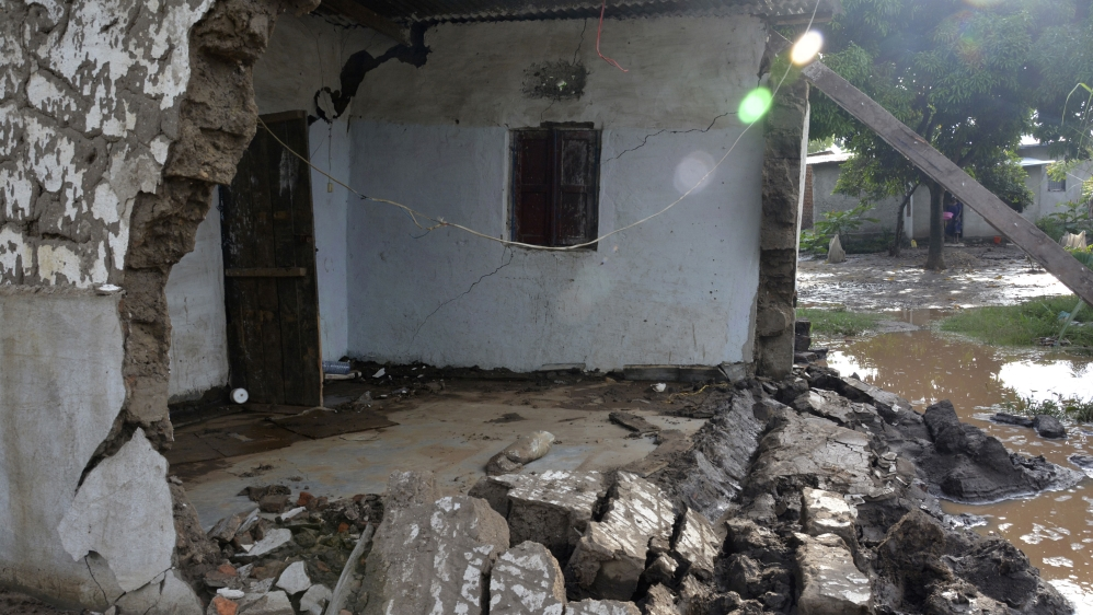 Roughly a month's worth of rain in a night destroys homes in Bujumbura.