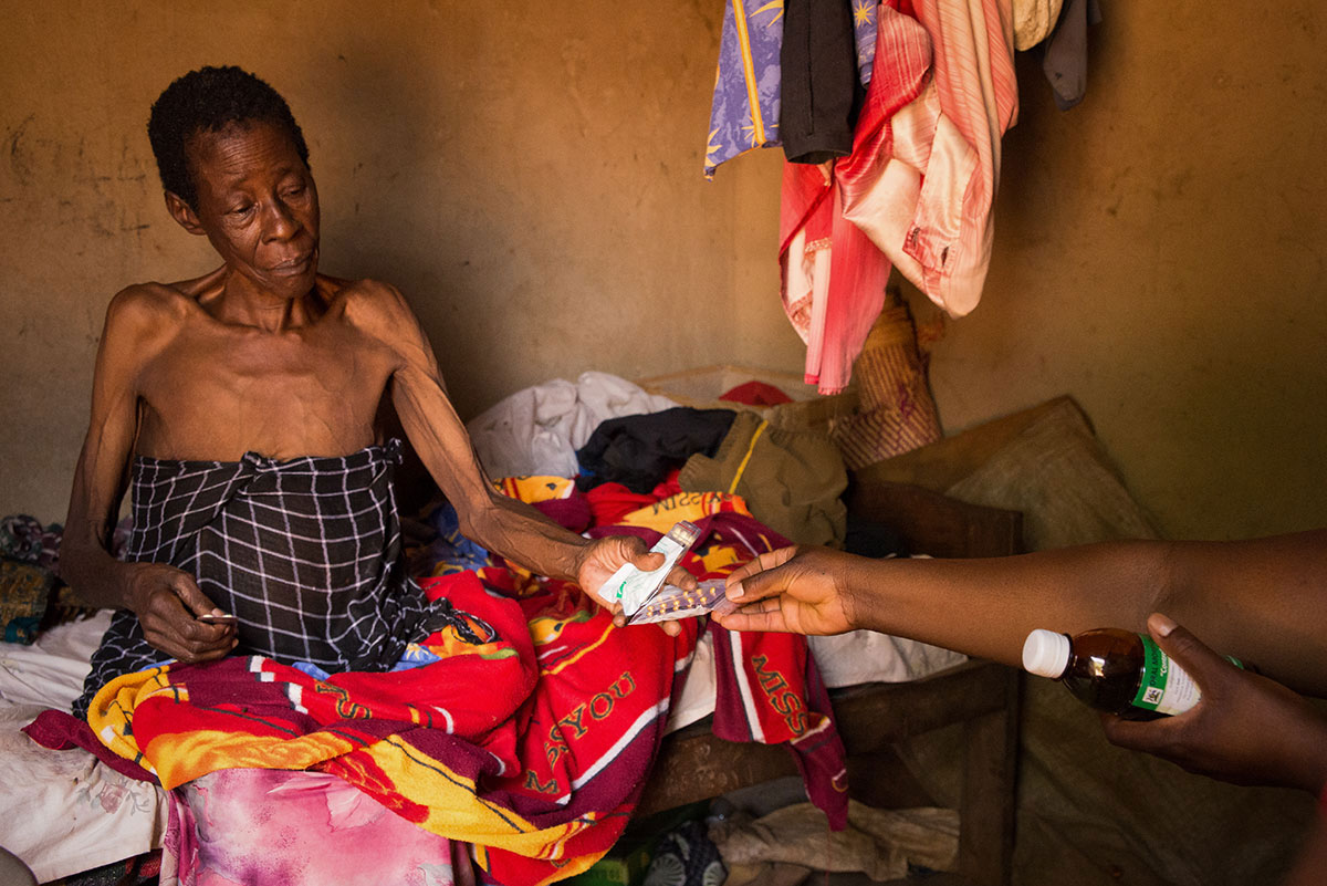 Nurses With Hospice Jinja Hand Grace Auma Her Monthly Allowance Of Pain Medication She Has Advanced Stage Cervical Cancer And Began Receiving Care From