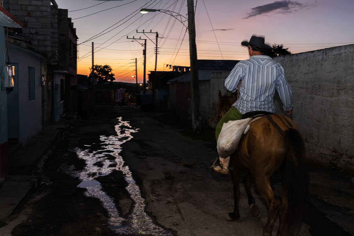 More than 50 percent of Cuba's water is lost through outdated water pipelines. Sometimes, miniature rivers flow through the streets, like here in Trinidad. [Sanne Derks/Al Jazeera]