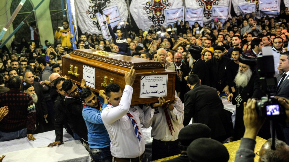 Egypt on edge as Christians bury dead from church attacks