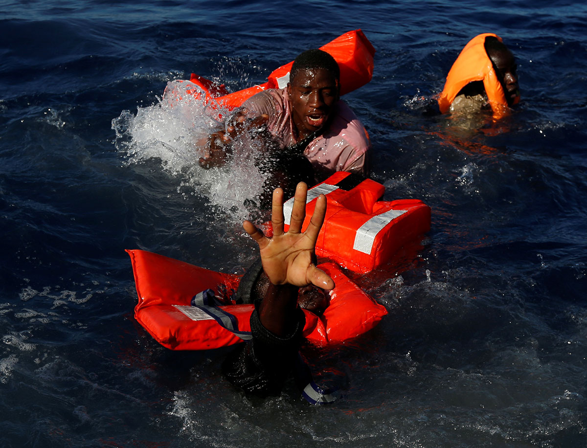 Asylum seekers are rescued in the Mediterranean Sea by the Malta-based NGO Migrant Offshore Aid Station. [Darrin Zammit Lupi/Reuters]
