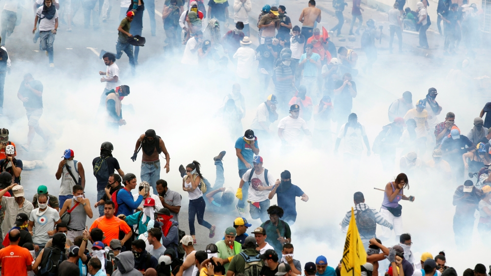 Venezuela's Maduro raps gas attack accusation by opposition figure