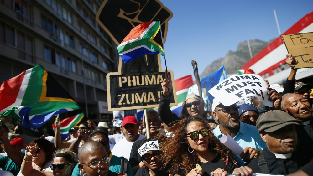 Largely peaceful protests come as a second ratings agency downgrades the country's debt rating to 'junk' status.