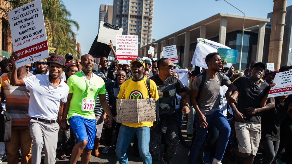 Hundreds angered by a rise in violence against women and children march in the South African capital, Pretoria.