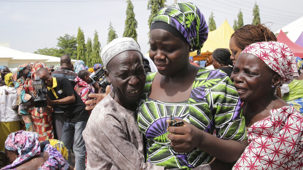 Scenes of joy as 82 schoolgirls freed from Boko Haram captivity see their parents for the first time since April 2014.