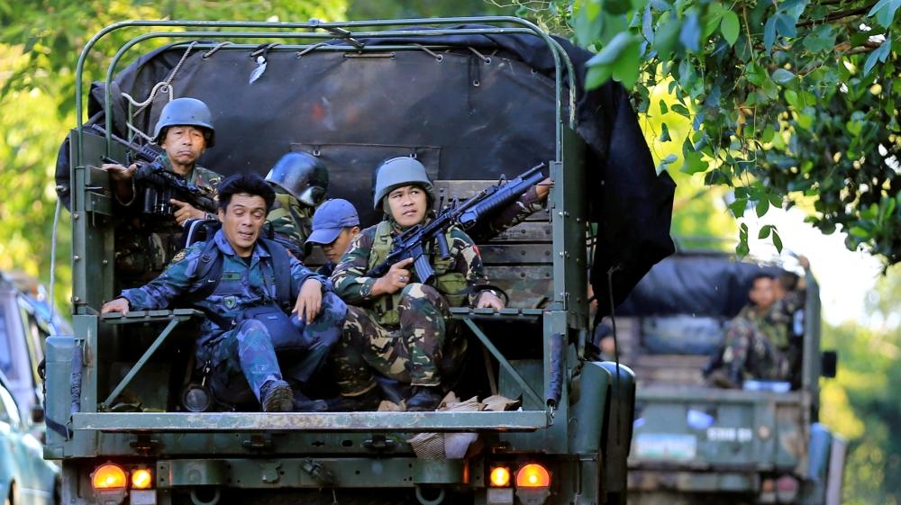 Crowds protest Duterte's martial law