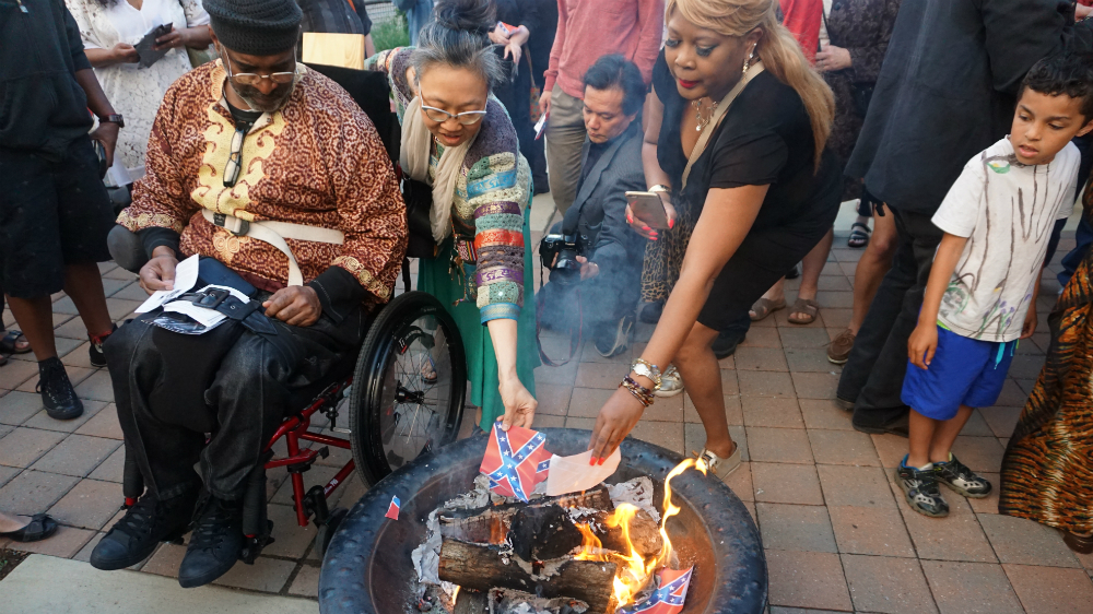 US activists burn Confederate flag on Memorial Day