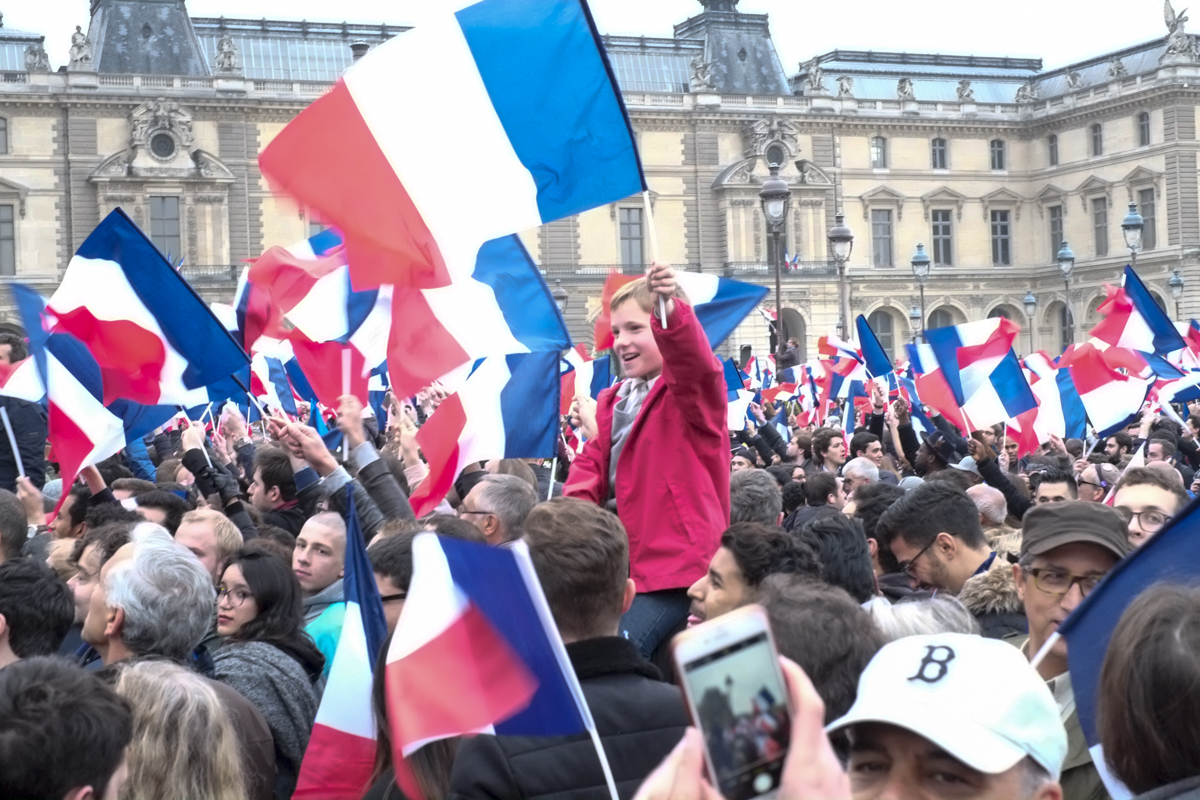 Tens of thousands wait for Emmanuel Macron, the centrist candidate who beat his far-right rival Marine Le Pen with more than 65 percent. [Raymond Bobar/Al Jazeera]