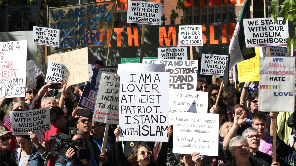 Counter-protesters hold signs and shout slogans during an anti Sharia rally in Seattle Washington