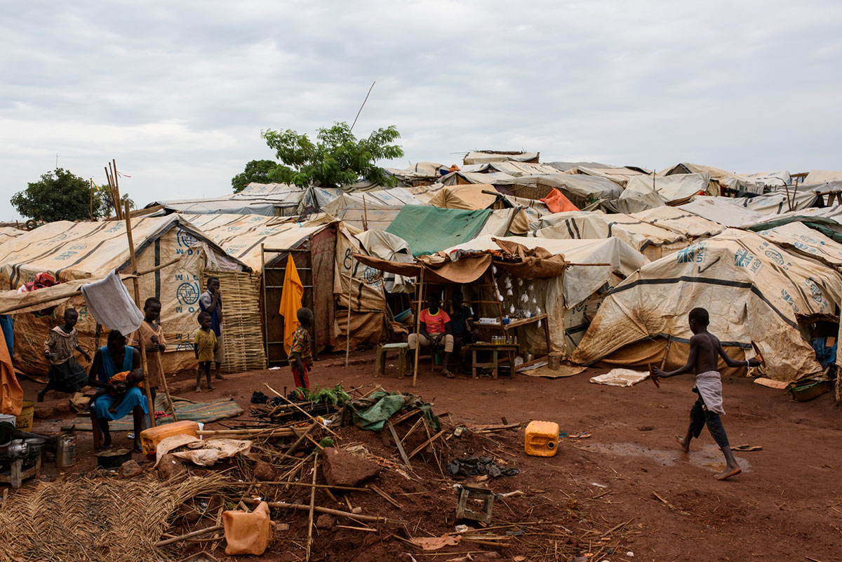 After fighting broke out in the city of Wau last year, thousands of people fled to the United Nations base seeking protection. Around 39,000 now live in the camp that has formed there, living in temporary shelters made of sticks and tarpaulins. [Phil Hatcher-Moore/UNICEF/Al Jazeera]