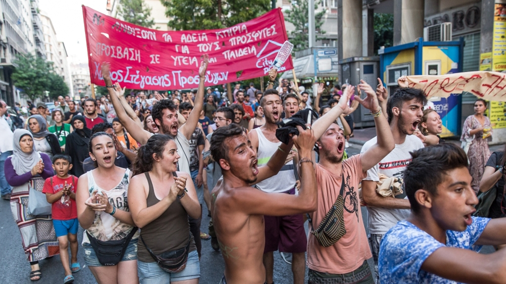 Greeks protest government crackdown on refugee squats
