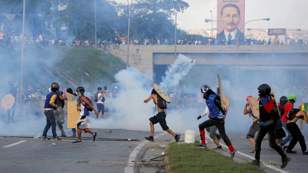 Slain protester's father appeals to 'friend' Maduro
