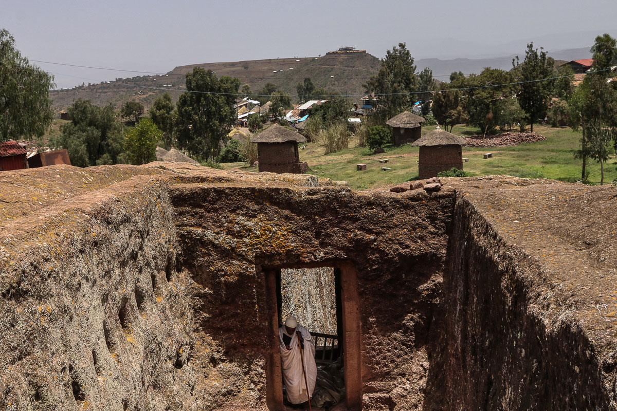 Lalibela's churches are situated in a mountainous region in the heart of Ethiopia, They are located amid a traditional village with circular-shaped dwellings called tukuls, where the people share their huts with their livestock at night. [Jenna Belhumeur/Al Jazeera]
