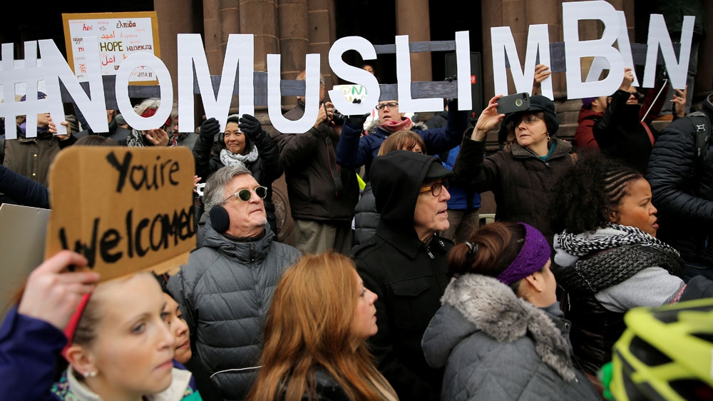 "Demonstrators spell out ""# No Muslim Ban"" during the ""Boston Protest Against Muslim Ban and Anti-Immigration Orders"""