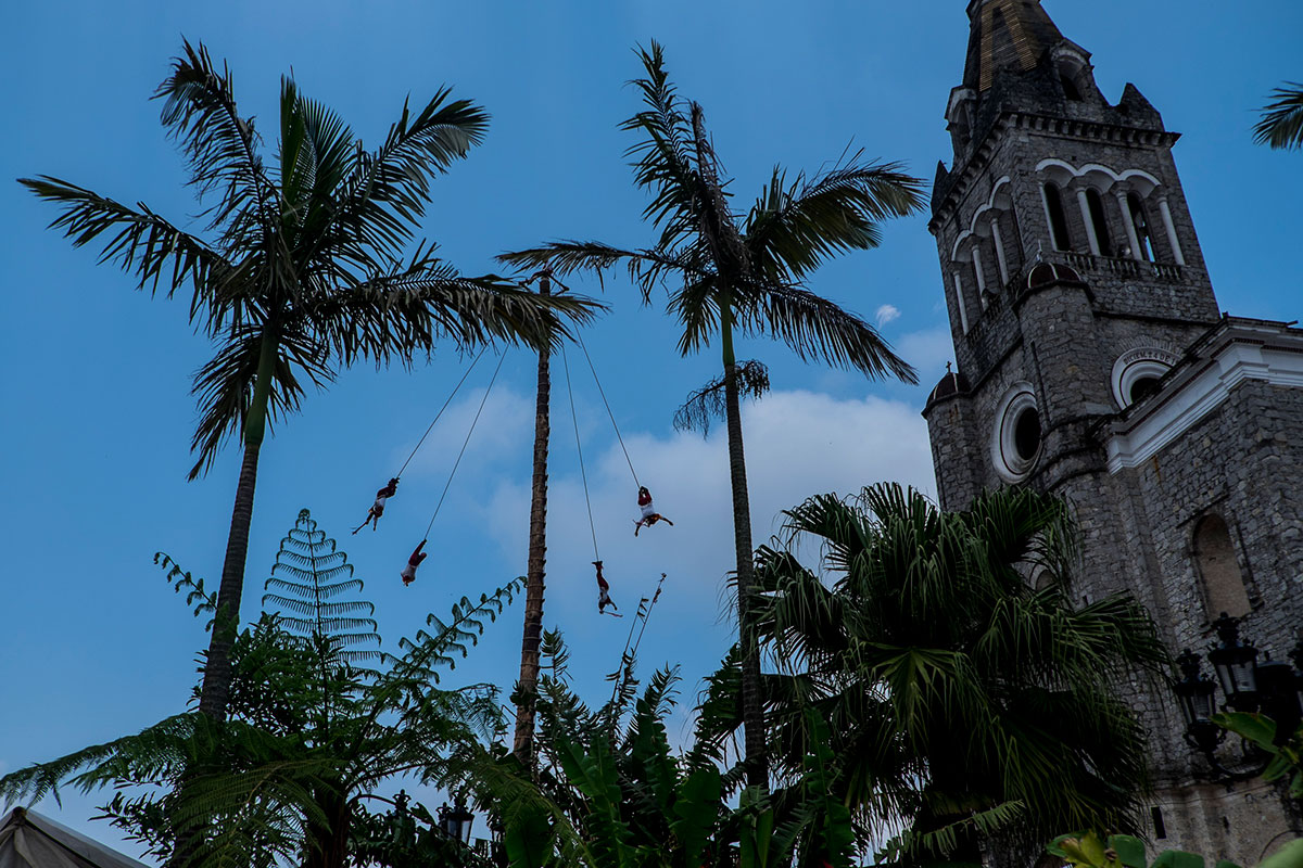 In the tropical region of Cuetzalan, Voladores fly weekly in front of the church to show off the ritual to tourists and villagers. [Sanne Derks/Al Jazeera]
