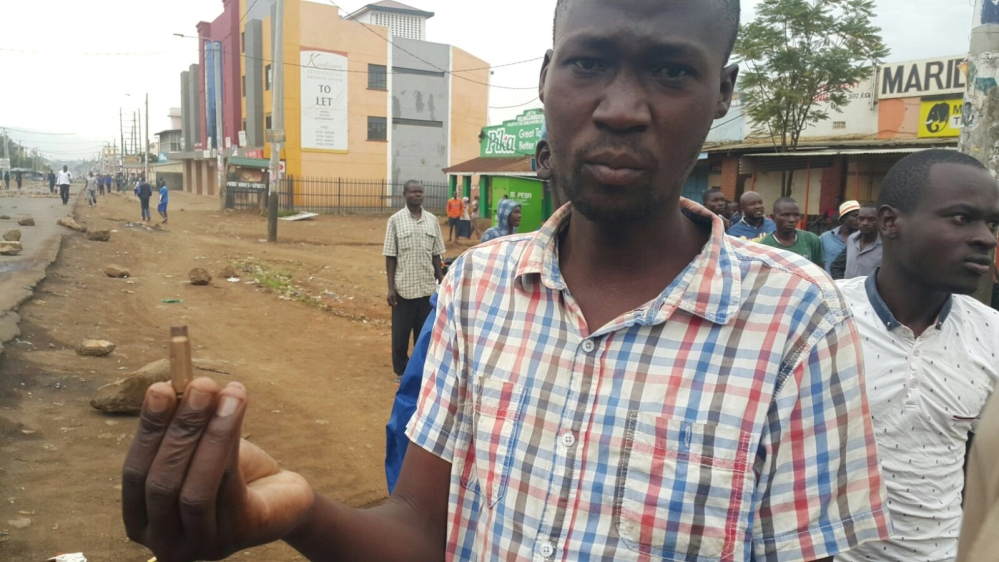Zaphania Onyango holds up a bullet shell he says was fired by security forces