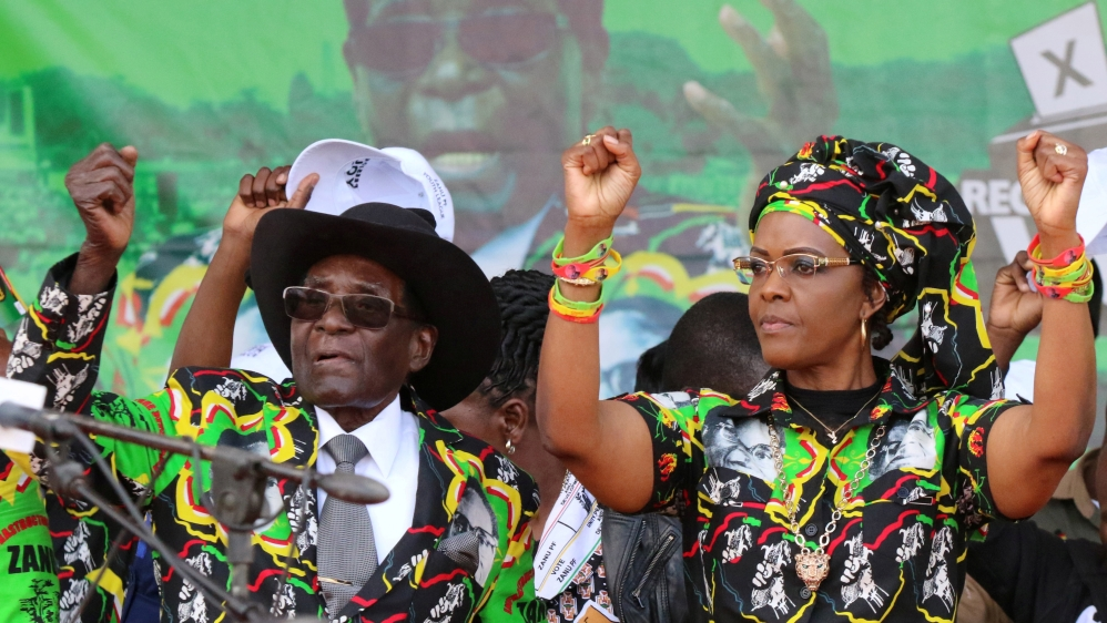 Accused of assaulting a model with an electric cable, police search for Zimbabwe's first lady to prevent her departure.