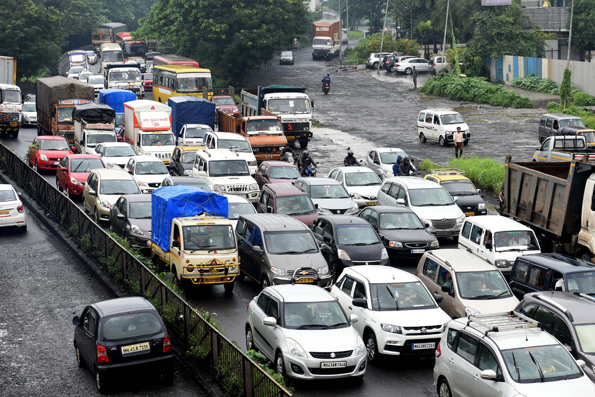Traffic grinds to a halt as water clogs the streets of Mumbai. [Praful Gangurde/Getty Images]
