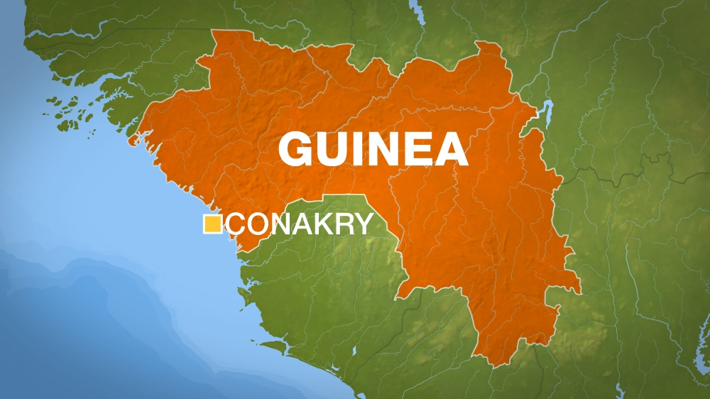 Rescue team search for survivors after landslide on a rubbish landfill on the outskirts of Conakry kills at least eight.