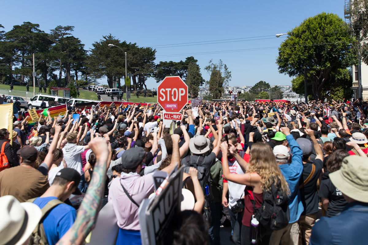 Hundreds gather outside Alamo Square on Saturday morning after police closed off the park following an announcement that Joey Gibson, of right wing group Patriot Prayer, would be holding a press conference there. The group cancelled its original rally in Crissy Field the previous day after opposition mounted. [Kelly Lynn Lunde/Al Jazeera]