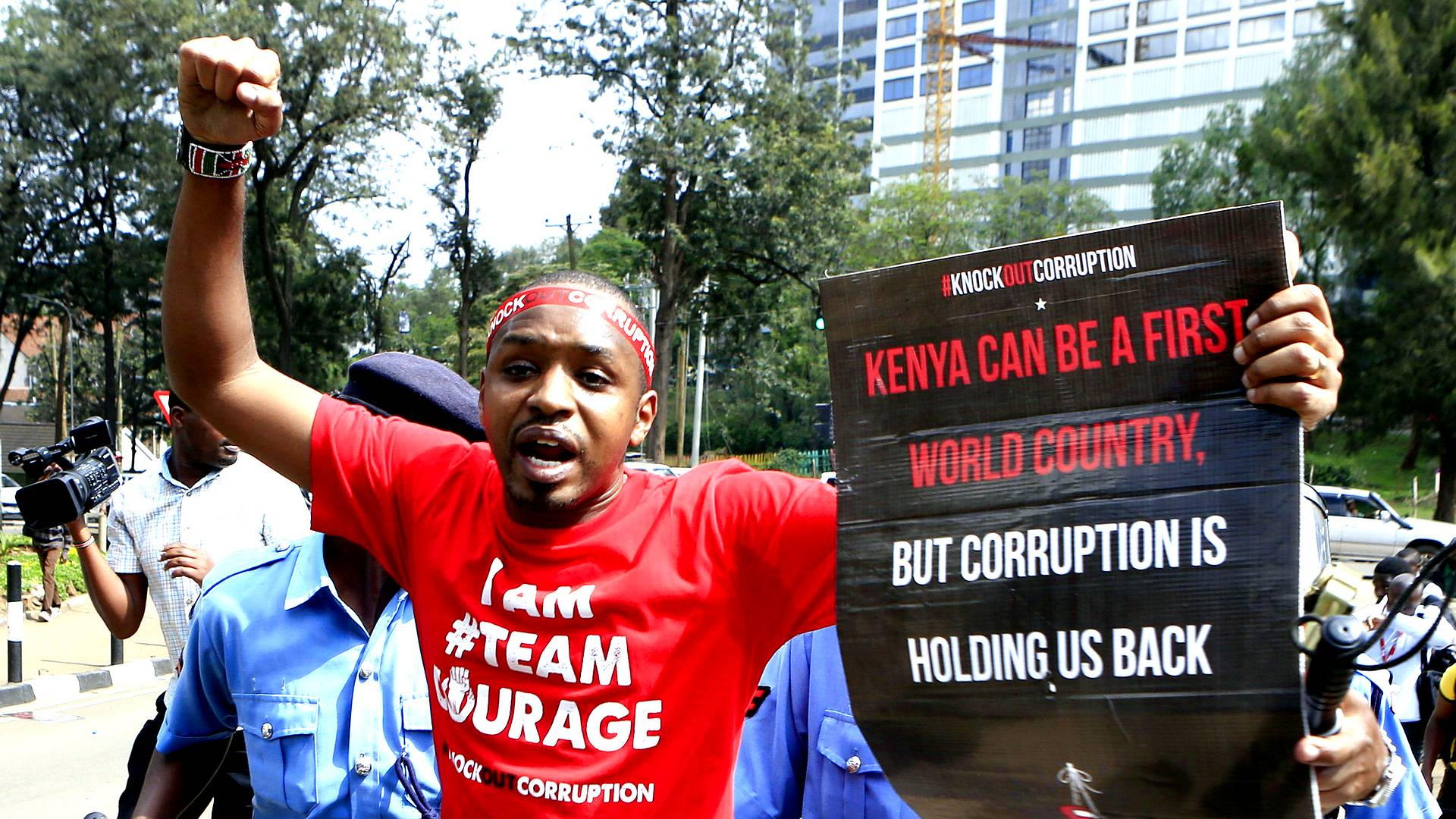 Murder of election chief casts shadow over next week's elections as many Kenyans take to streets to demand justice.
