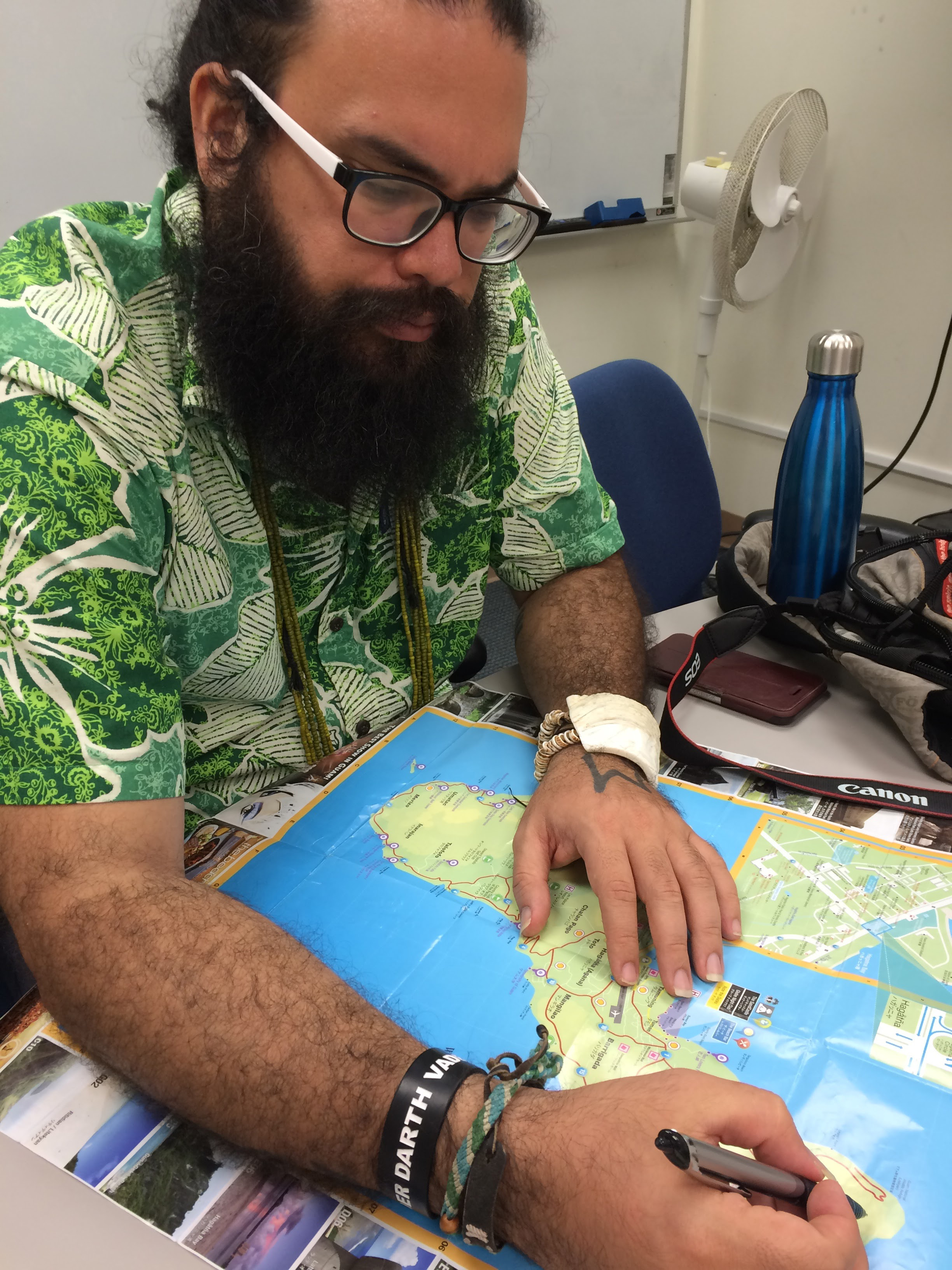 Michael Lujan Bevacqua Uses A Map To Show Where Us Bases On Guam Are Located The Military Occupies Nearly One Third Of The Island Jon Letman