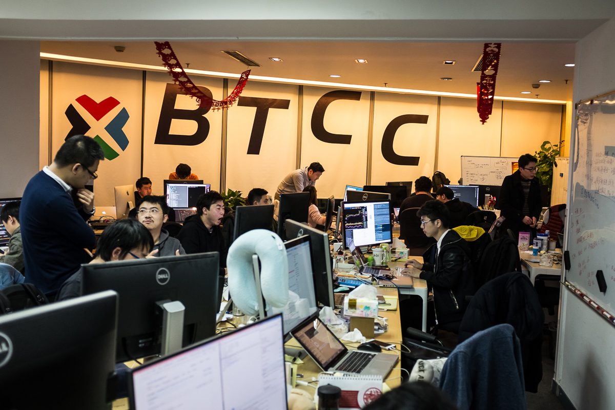 Employees work at the BTCChina office, in Shanghai's financial district. BTCC was founded in 2011 and is now one of China's largest bitcoin exchange platforms. According to its CEO Bobby Lee, Chinese people like the 'online gambling' feel of bitcoin's instability; also, with the Chinese government's restrictions on many investment channels, people welcome new ways to invest their money. [EPA/Liu Xingzhe/CHINAFILE]