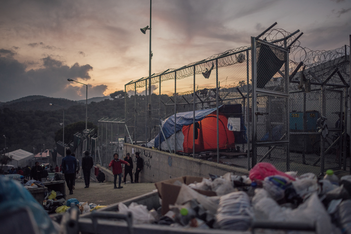 A former military base, the site of Moria camp can easily be mistaken for a prison. Stretching along a hilltop and with many fenced sections, it is confusing to find your way around. [Kevin McElvaney/Al Jazeera]