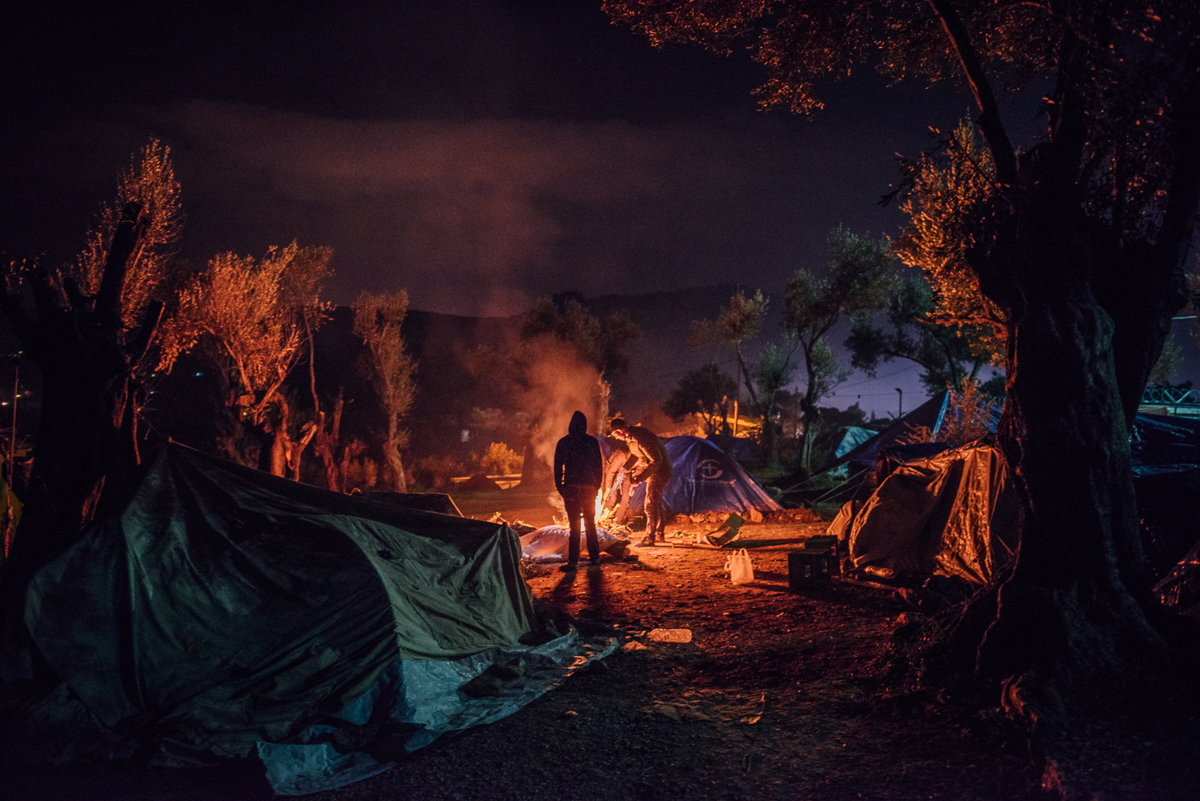 Makeshift tents spread across the olive grove outside Moria camp. People here have no access to electricity or sanitary facilities. [Kevin McElvaney/Al Jazeera]