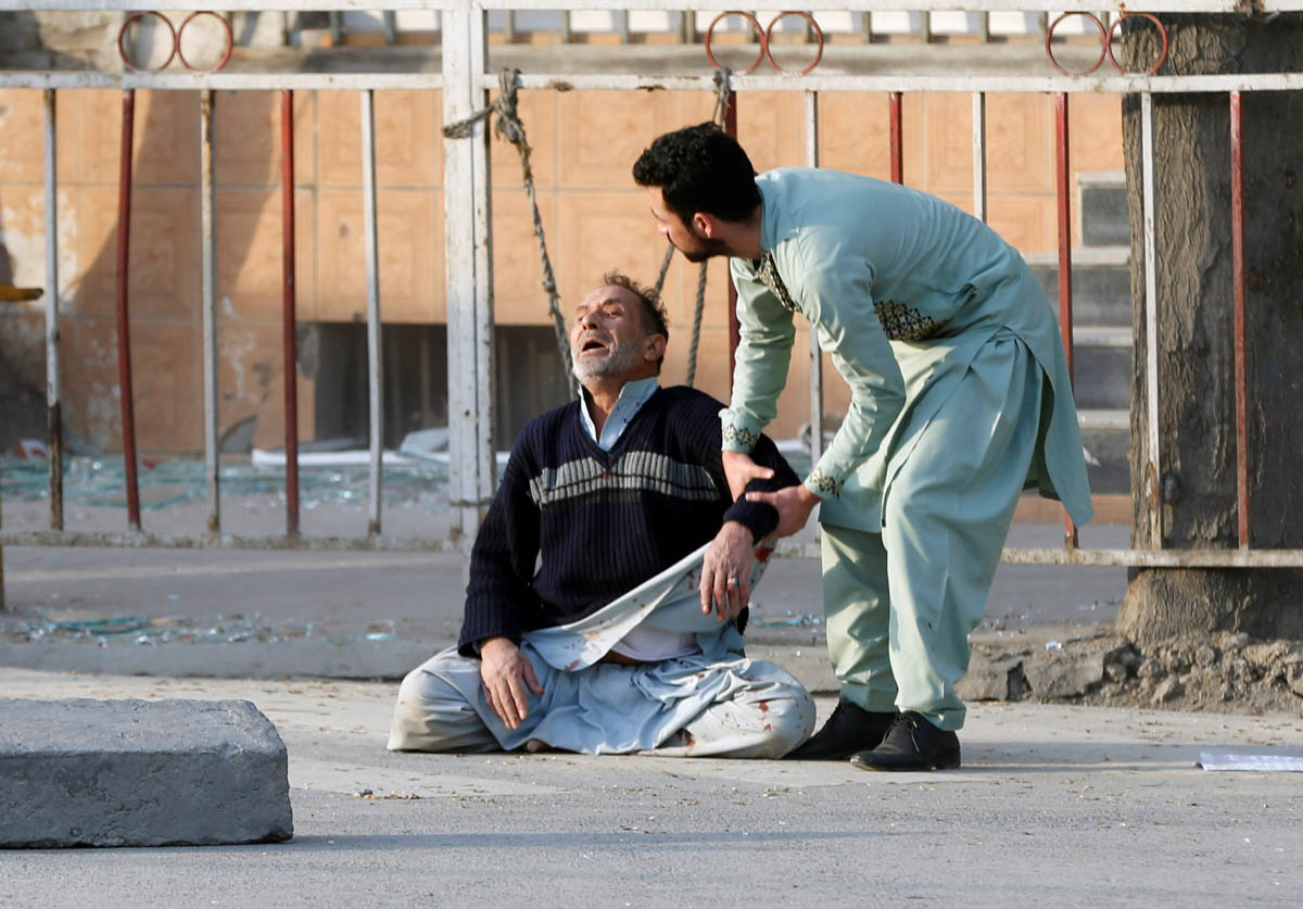 A man reacts after hearing his son was killed during a car bomb attack in Kabul, Afghanistan. [Omar Sobhani/Reuters]