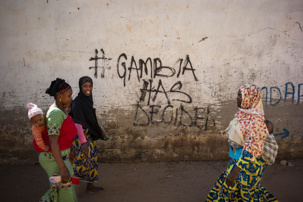 The hashtag #GambiaHasDecided has appeared on walls throughout the country since December 9, 2016, the day Yahya Jammeh refused his defeat and vowed to remain in power despite losing the election to Adama Barrow. [Nicolas Leblanc/Al Jazeera]