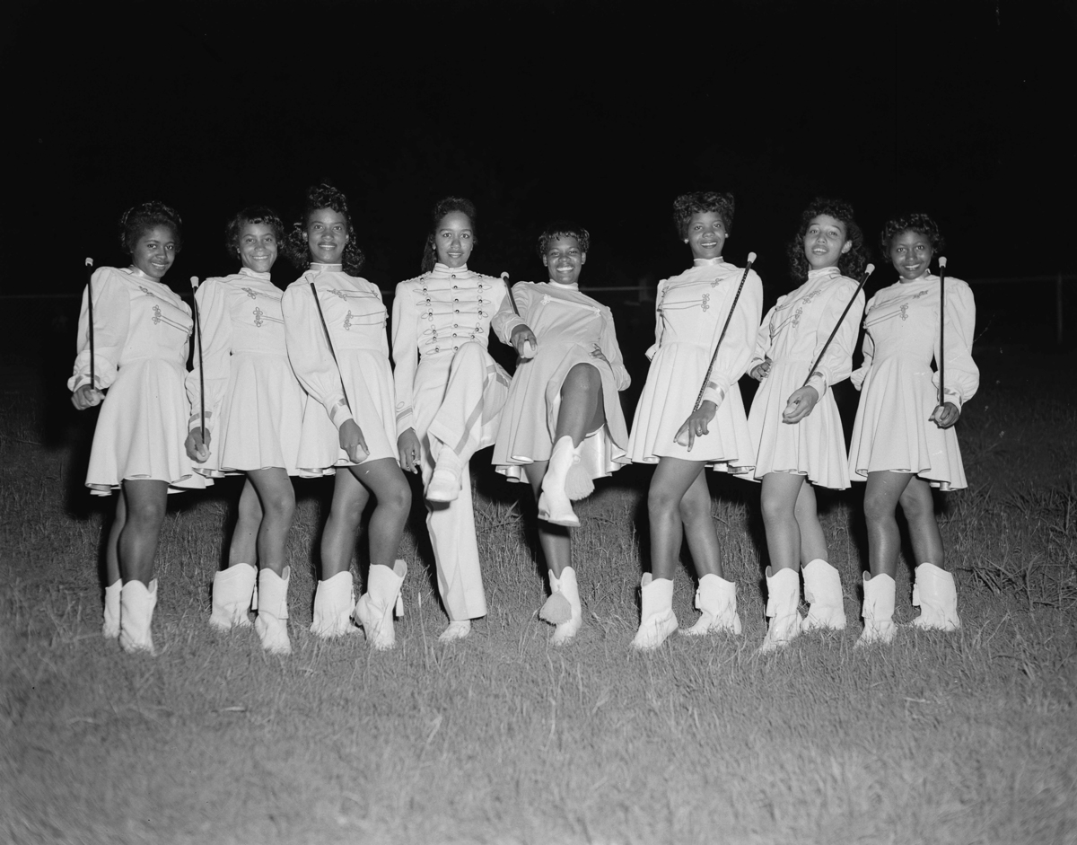Members of Fort Worth's Como High School band pose for Calvin Littlejohn's camera in 1958. Littlejohn moved to Fort Worth in 1934 during the Jim Crow era, when mainstream newspapers wouldn't publish pictures of black citizens and white photographers wouldn't take pictures in black schools. Unperturbed, Littlejohn dedicated his career to capturing images of his adopted home and its black community. [Calvin Littlejohn; Calvin Littlejohn Photographic Archive, Briscoe Center for American History]