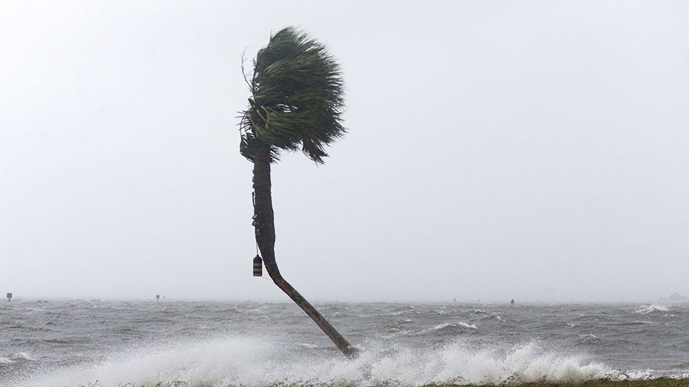 Michael downgraded to tropical storm, kills 2 in Florida
