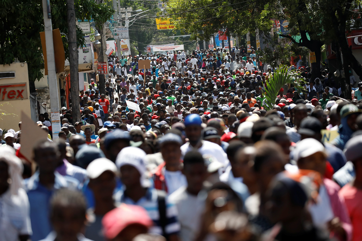 Protesters march to demand an investigation into what they say is the alleged misuse of a Venezuela-sponsored oil programme. [Andres Martinez Casares/Reuters]