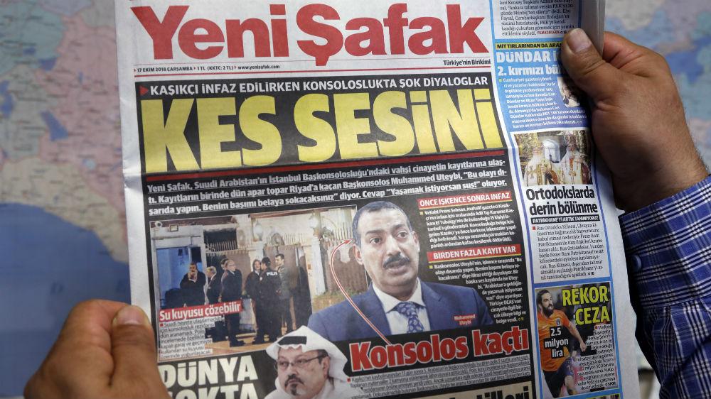 e597651cc9c A man holds a Yeni Safak newspaper with the headline    To the Saudi  consul  Shut up   Burhan Ozbilici AP