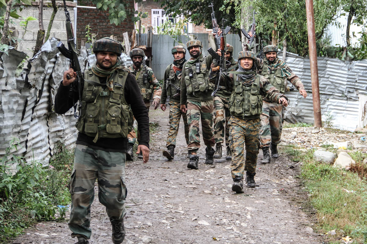 Indian soldiers after the killing of five rebels in Qazigund area in South Kashmir last month. India has stationed nearly 700,000 troops in the Himayalan region, making it the world's most militarised conflict zone. [Sameer Mushtaq/Al Jazeera]