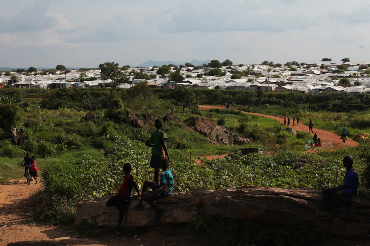 Children walk outside the POC in Juba, South Sudan, home to more than 40,000 people. [Andreea Campeanu/Al Jazeera]